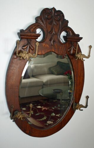 "Antique Carved Oak Hall Mirror with Ornate Hooks and Beveled Glass - 38"" X 27"""