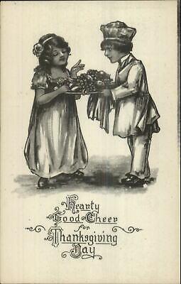 Thanksgiving Boy Chef Serves Fruit Platter to Girl Gravure Series Postcard](Thanksgiving Fruit Platter)