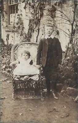 Postcard  Edwardian Children In garden Real photo seasons Greetings
