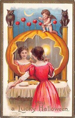 upid Shooting Woman Looking Into Pumpkin Mirror~124256 (Cupid Halloween)