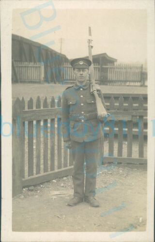 WW1 South Wales Borderers Soldier Photo At camp with rifle  fence