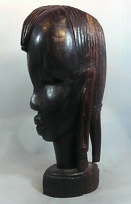 A Well Carved African Bust of a Woman. Masai. 6 inches or 15.5 cm
