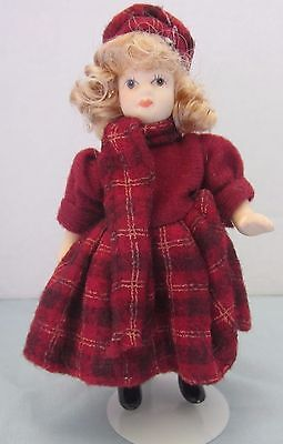 Porcelain doll 5 inches tall with blonde hair and winter burgundy dress