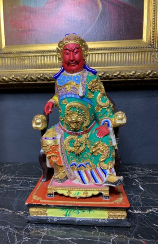 A Large Carved Figure of Guan Yu Sitting on the Throne
