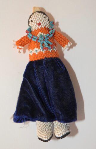 Fully beaded Zuni female doll