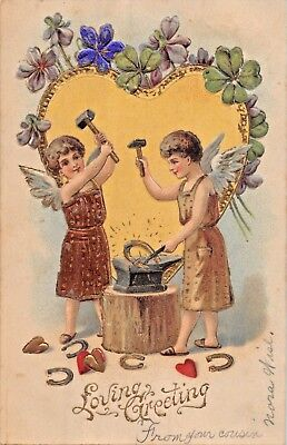 LOVING GREETING~GILT CUPIDS MAKING GOLD HEARTS & SHOES~EMBOSSED POSTCARD 1900s
