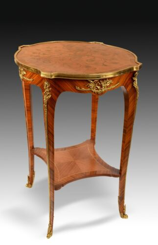 Louis XV style side table with bronze and marquetry work. 20th century.