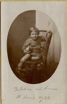 VTG Small Child Holding Ball Sitting in Wicker Chair RPPC Photo Postcard A8 ()