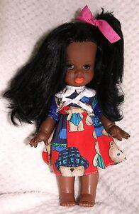 Adorable petite poupée noire ancienne 28 cm - France - État : Occasion: Objet ayant été utilisé. Consulter la description du vendeur pour avoir plus de détails sur les éventuelles imperfections. ... - France