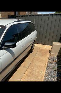 Wrecking white Holden vy wagon