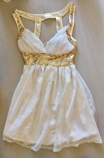 Women's size 6-8 dress white with gold bling  new without tags