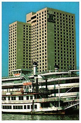 STEAM BOATS & THE NEW ORLEANS HILTON ON MISSISSIPPI LOUISIANA POSTCARD COND: VG