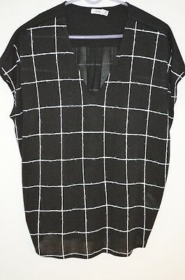 80% Rayon 20% Polyester (Vince Black Check 80% Rayon/20% Polyester V-Neck Sleeveless Blouse Size)