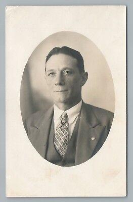 Men's 1920s Style Ties, Neck Ties & Bowties Wrinkled Man in Patterned Tie RPPC Antique European Studio Photo~1920s $9.99 AT vintagedancer.com