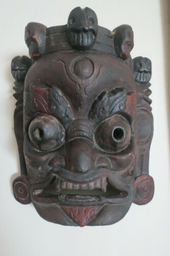 ASIAN WOOD CARVED DEATH MASK WITH WAX IMPORT STAMP