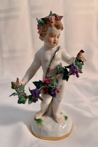 MEISSEN SIGNED FIGURINE HOLDING A GRAPE VINE CIRCA 1880....EXCELLENT.