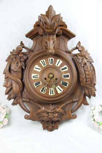 Antique Black Forest wood carved hunting satyr devil head deer fish bird clock