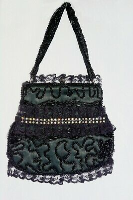 1940s Handbags and Purses History Delicate 40's 50's vintage beaded purse with rhinestone and lace accents $39.77 AT vintagedancer.com