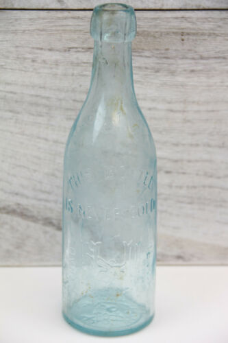ANTIQUE 1878 HENNESSY NOLAN ALBANY NY AQUA EMBOSSED GLASS BOTTLE NEW YORK DECOR
