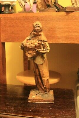 Large retro collectable paper-mache model of an old woman carrying basket of