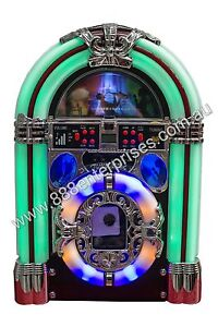 Mini Tabletop Jukebox with wooden finish. Plays Mp3, USB & SD, CD, Radio, Remote