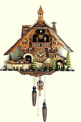 Schwarzwälder Kuckucksuhr Schwarzwaldhaus Quarz bewegliche Eisenbahn Zug Musik