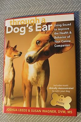 Brand New Book THROUGH A DOG'S EAR with Dog Calming Music CD ISBN 9781591798118 ()