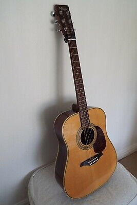 Vintage V1100N acoustic guitar with solid spruce front and solid rosewood back.