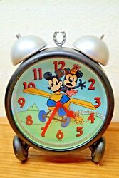 OLD STYLE MICKEY MINNIE MOUSE ALARM CLOCK ON PLANE