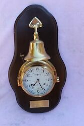 HOWARD MILLER WALL CLOCK 613-463 BRASS SHIP STYLE W/ BELL ON WOOD PRESENTATION