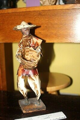 Large retro collectable paper-mache model of an old man with hat carrying basket