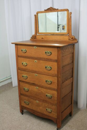 Antique golden oak highboy dresser beveled mirror and original brass hardware