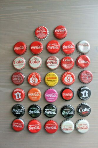 SET OF 32 DIFFERENT WORLDWIDE USED COCA-COLA/COKE BOTTLE CAPS (SOME RARE!!)