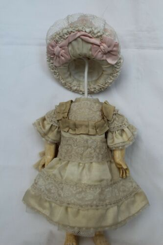 "Silk dress and hat for antique baby doll 12""."