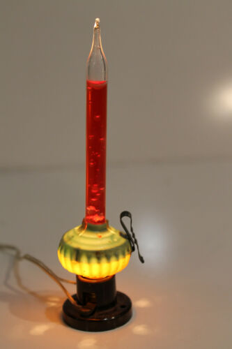 red shooting star bubble light tube (clear bubbles in red liquid)