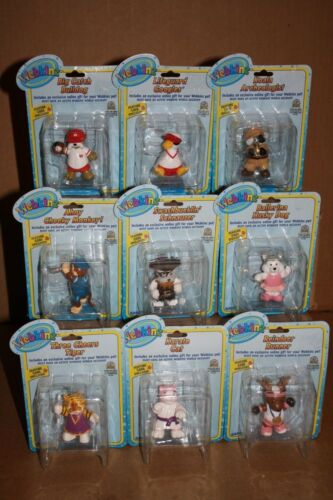 Collection of 9 Webkinz figures new in package includes feature code in each box
