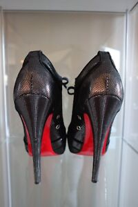 Christian Louboutin Lace Up Pumps
