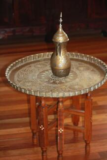 Antique brass round table with fold wooden carved stand