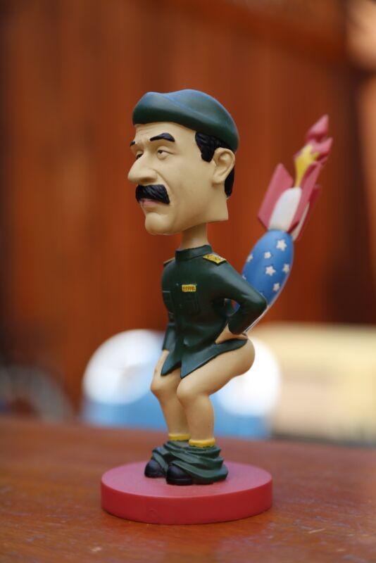 RARE: Saddam Hussein bobblehead with American bomb in butt