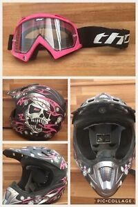 Pink, white and black full  face helmet with goggles