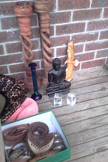 Various items including Buddha, jewelry, candle holder