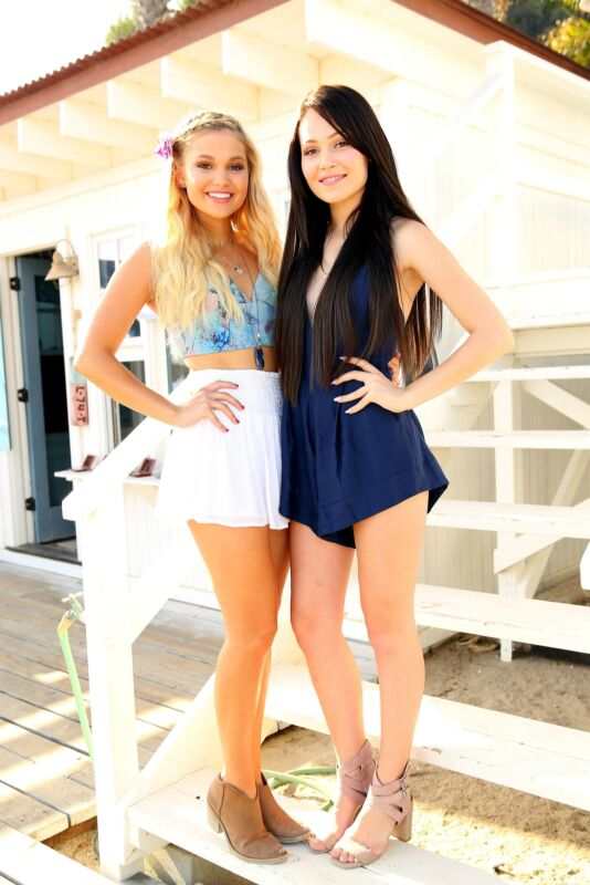 Olivia Holt Posing With Her Friend On The Stairs 8x10 Photo Print