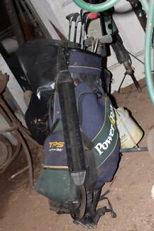 Golf clubs, bag and buggy