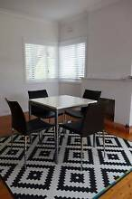 White table with 4 black chairs Seaforth Manly Area Preview