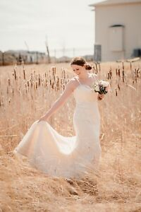 Beautiful low back lace wedding dress with jewel detail