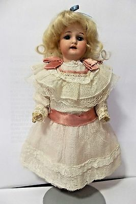 VERY NICELY DRESSED 8 1/2 INCH ARMAND MARSIELLE BISQUE HEAD GIRL DOLL