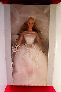 LOVE BARBIE DOLLS HERE IS AN AVON BARBIE COLLECTIBLE BLUSHING BRIDE NEW IN BOX