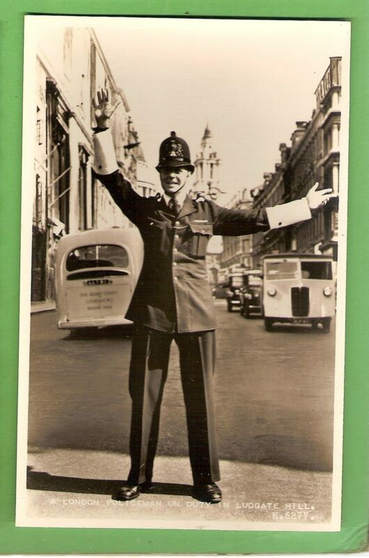 #J.   POSTCARD -  LONDON  POLICEMAN DIRECTING TRAFFIC