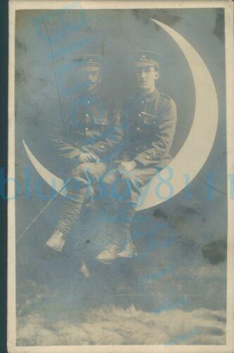 WW1 Brecknockshire battalion Soldiers sat on crescent moon Studio photo