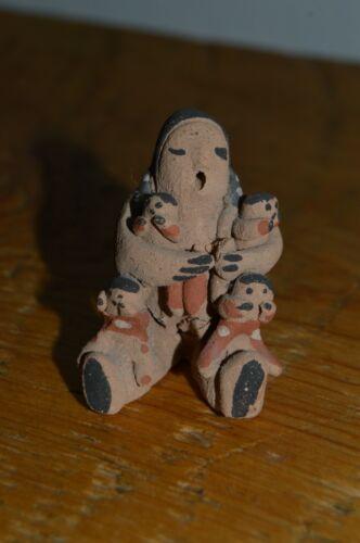 "Miniature 1 5/8"" Native American Storyteller figure with 4 children, signed Jun"